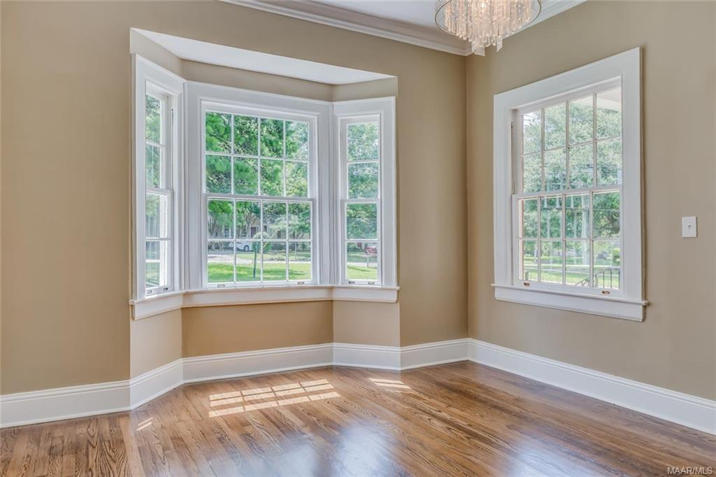Dining room features bay window, now open to livin