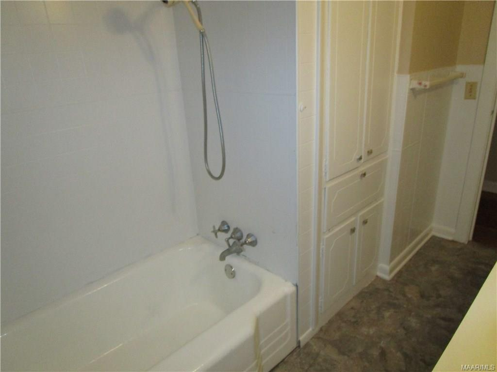 Tub in hall bath and linen closet