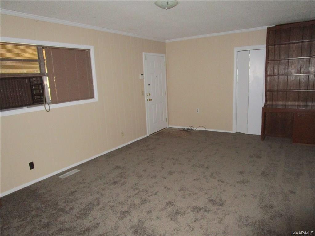 Family room w/door to carport