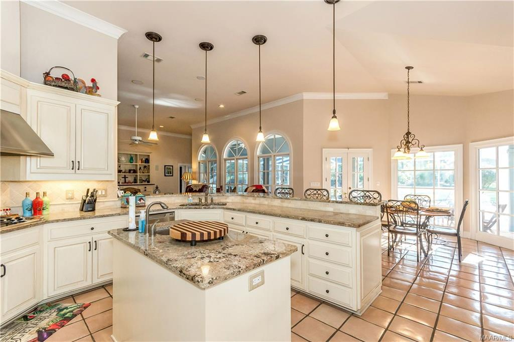 Wonderful kitchen with work island and wrap around
