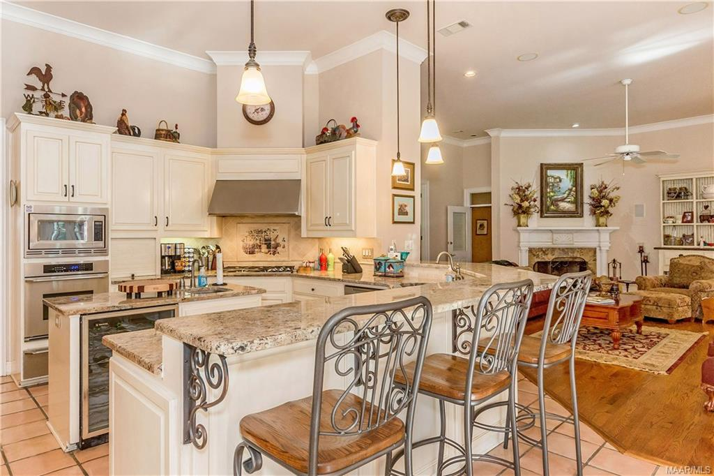 Kitchen features granite countertops, gas cooktop