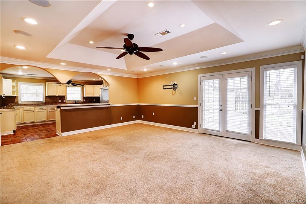View from hallway thru den into kitchen