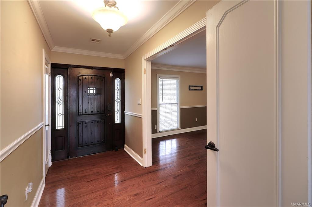 Beautiful front entrance, foyer features same wood