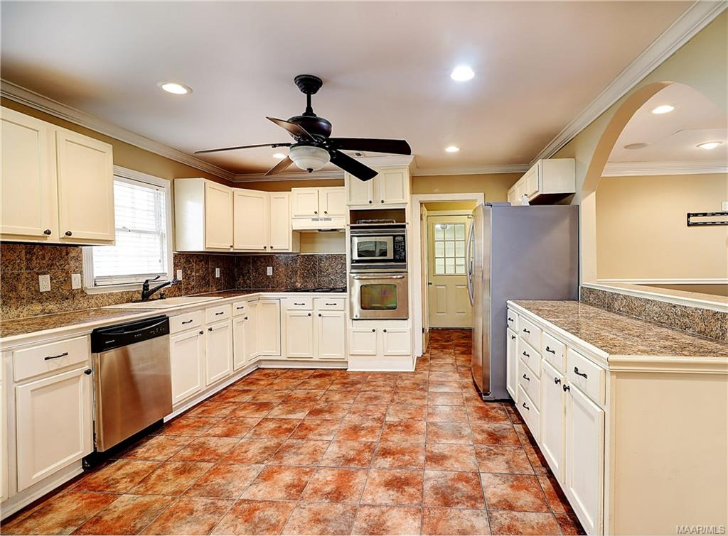 Kitchen features granite, stainless appliances, up