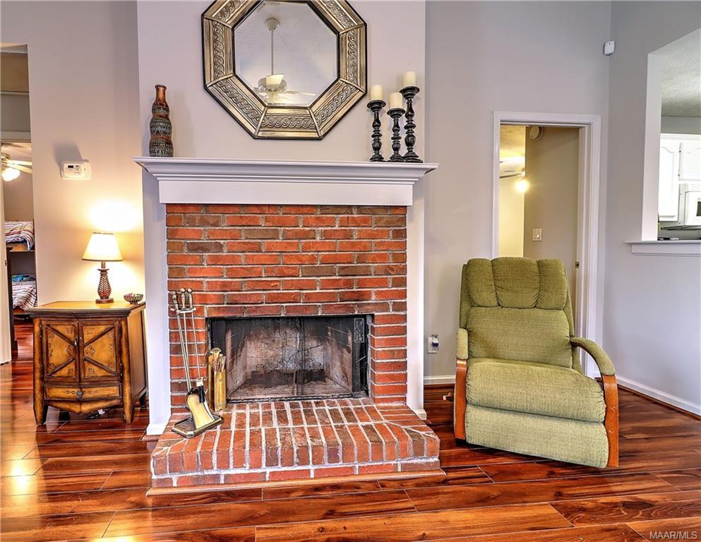 Wood burning fireplace and beautiful laminate floo
