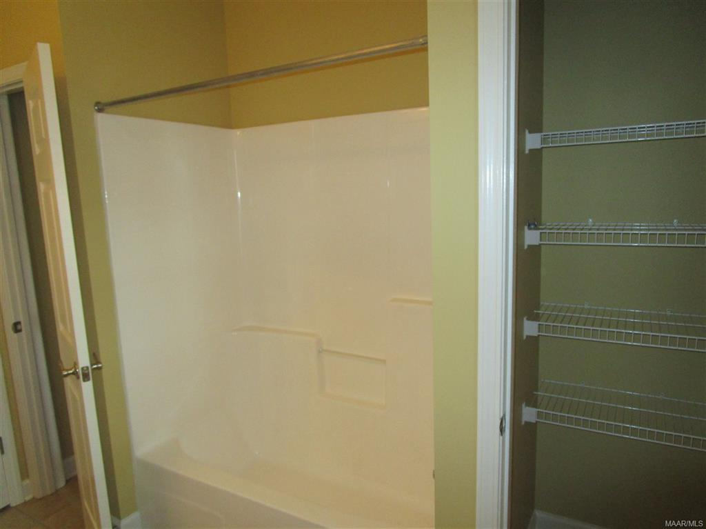 Two closets in hall bath