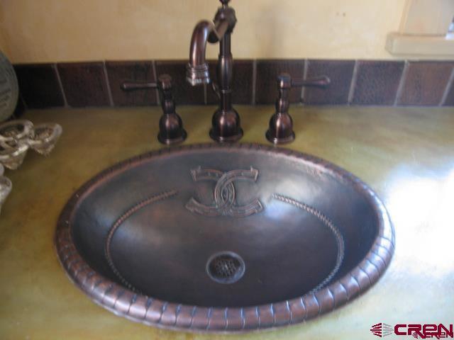 Custom copper sinks in the bathrooms.