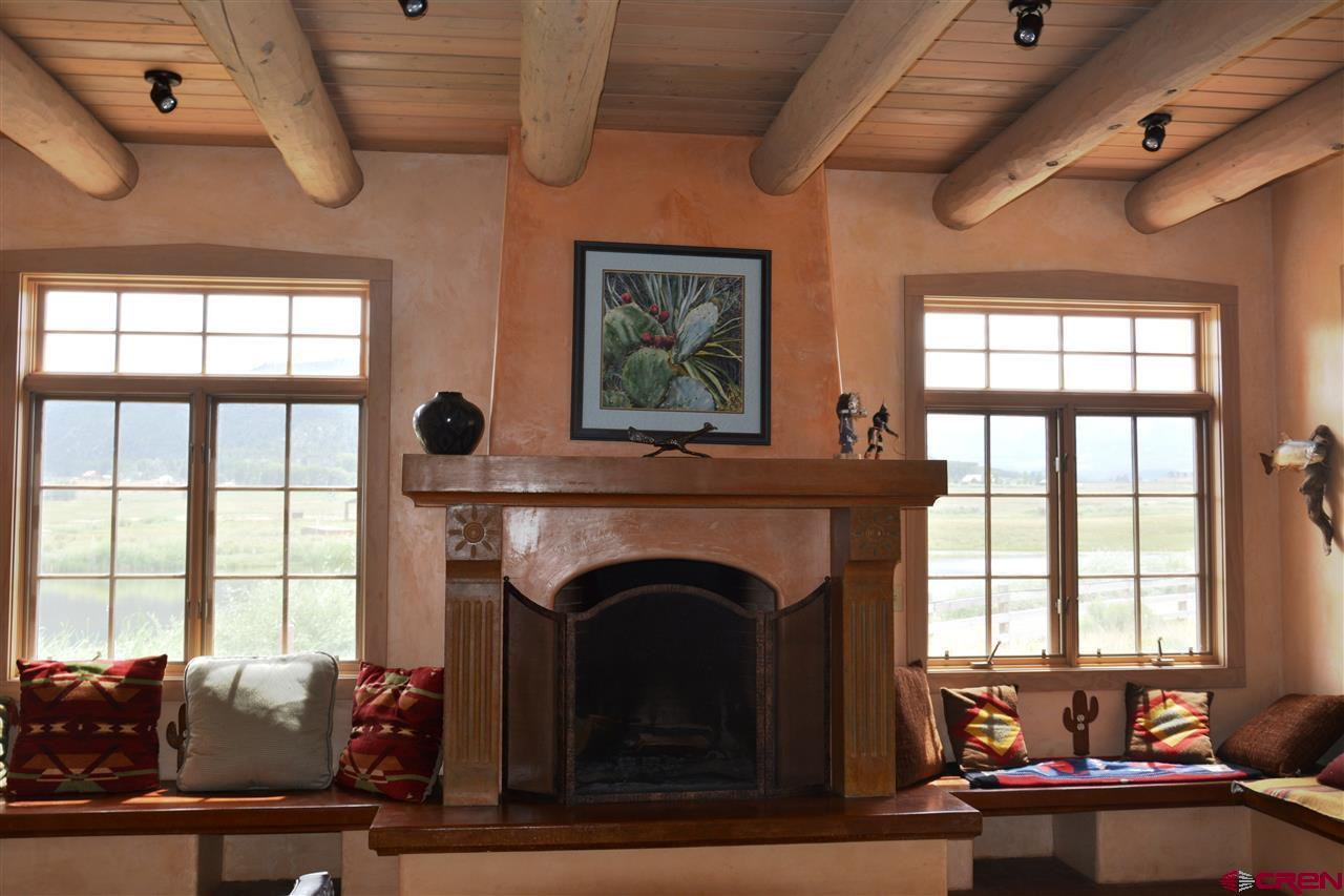 Views, massive fireplace, custom timbers, hand pla