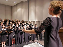 Heather Zosel rehearses with the choir before performance