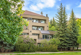 Top Floor Two Storey Lofted Condo with Downtown Views in Patterson