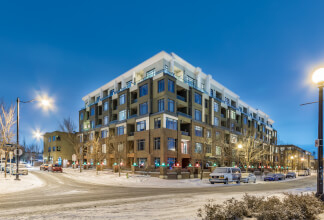 Unobstructed Southwest Views from this Top Floor Corner Suite in Bridgeland with 3 Titled Parking Stalls