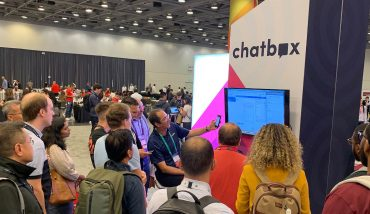 Image showing Chatbox booth performing a demo a Twilio Signal Conference