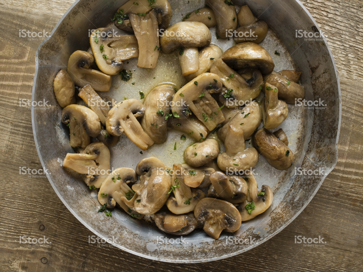 Add flavored butter to sautéed mushrooms.
