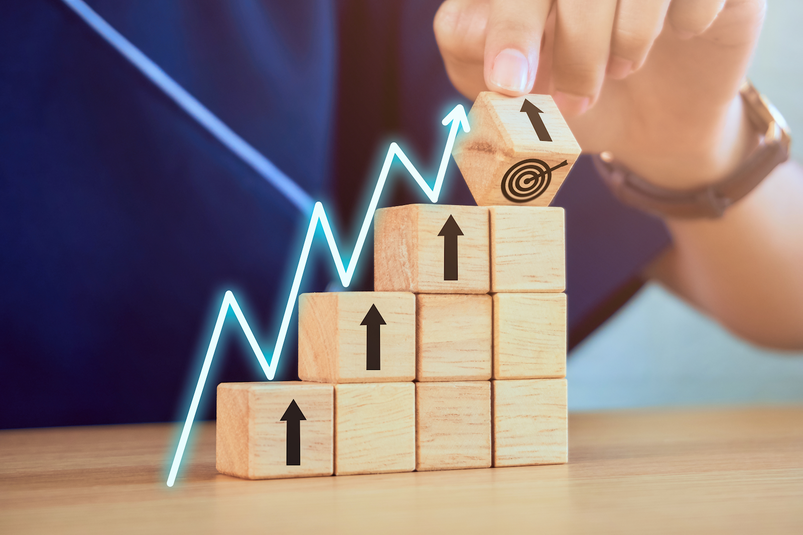 Alt Text: Blocks with arrows pointing up, symbolizing investment goals and growth