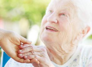 Giving a hand up to senior woman