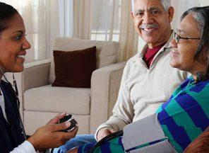 Healthcare provider and senior couple