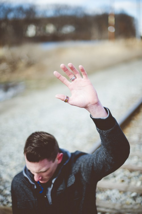 man, prayer, praying, kneeling, train, tracks, railroad, hand, raised