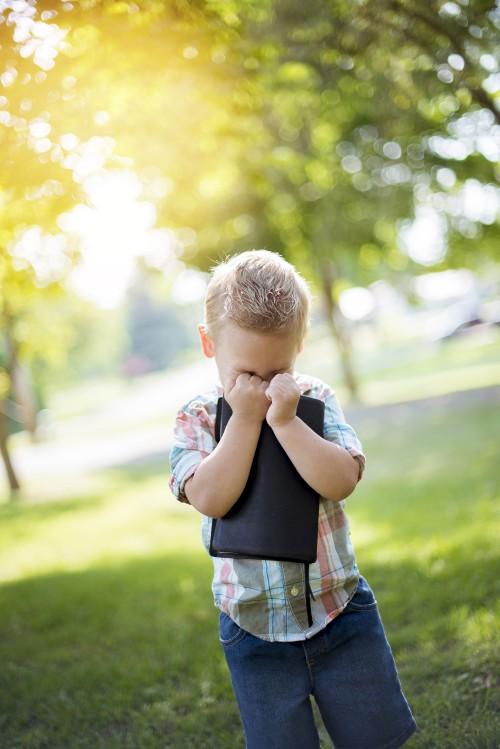 boy, child, kid, bible, reading, holding, smiling, laughing, grass, sun, praying