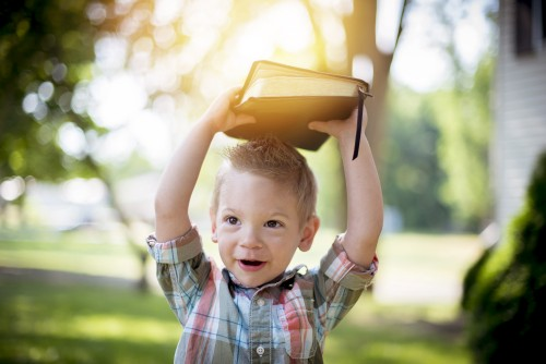 boy, child, kid, bible, reading, holding, smiling, laughing, grass, sun