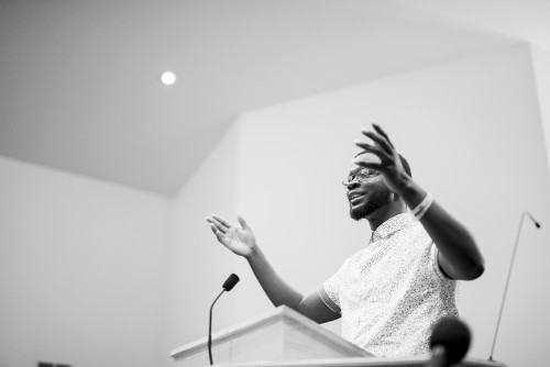 man, preacher, paster, speaker, speaking, talking, teaching, sermon, service, church, pulpit, sunday, auditorium, platform, black, white