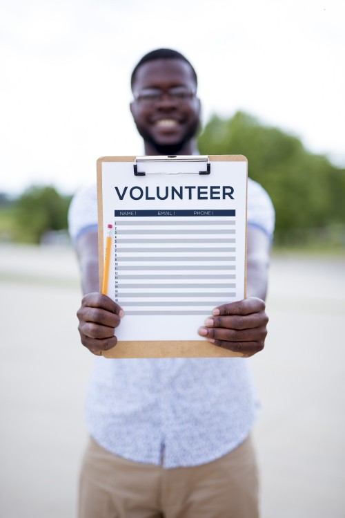 man, clipboard, sign, up, volunteer, outreach, checklist, holding, standing, outdoors, outside, writing, names, paper, board, list, contact, information, sheet
