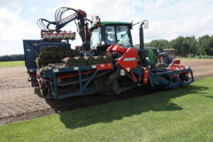 Turf harvesting machine