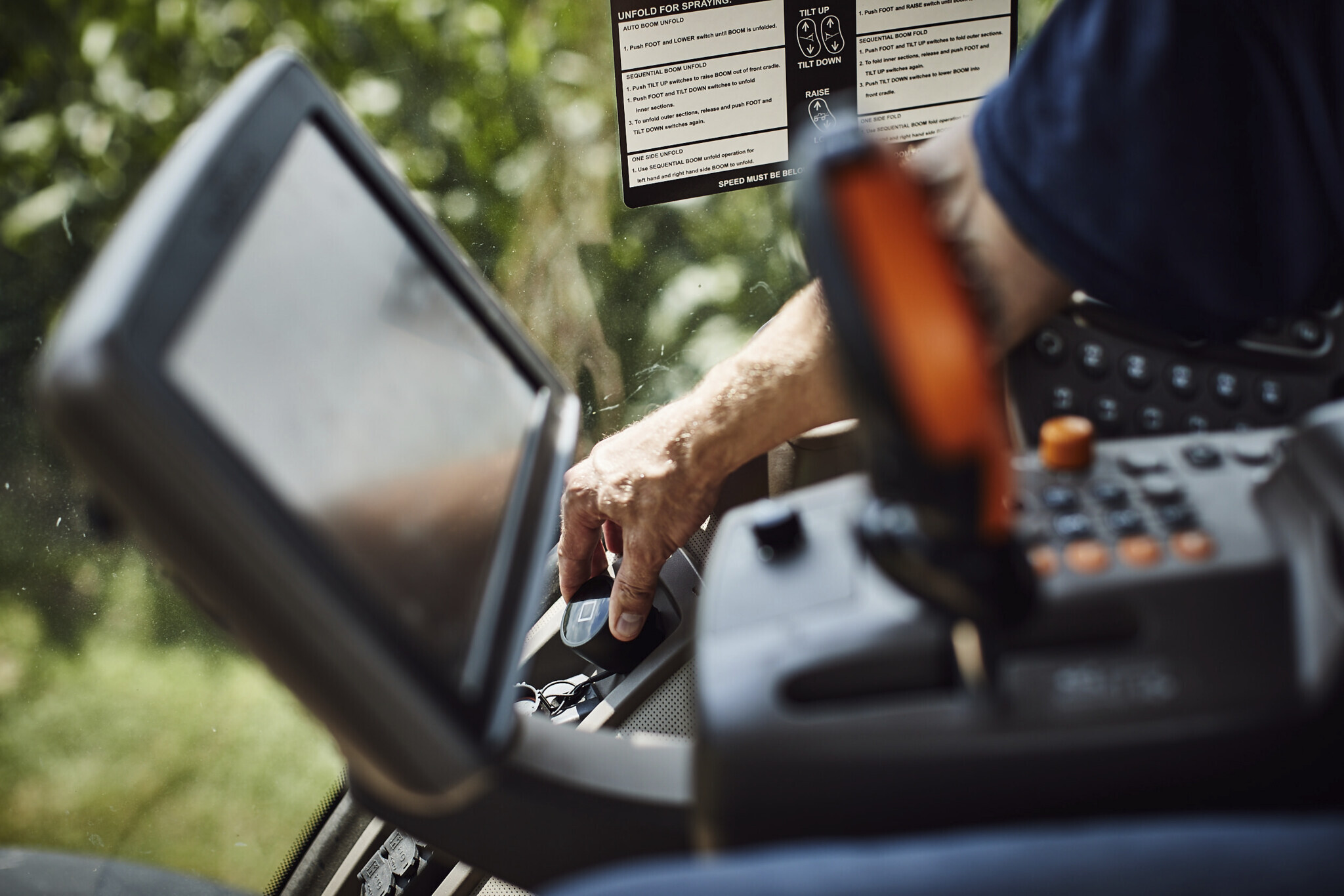 A farmer working in a tractor holding the FieldView Drive.