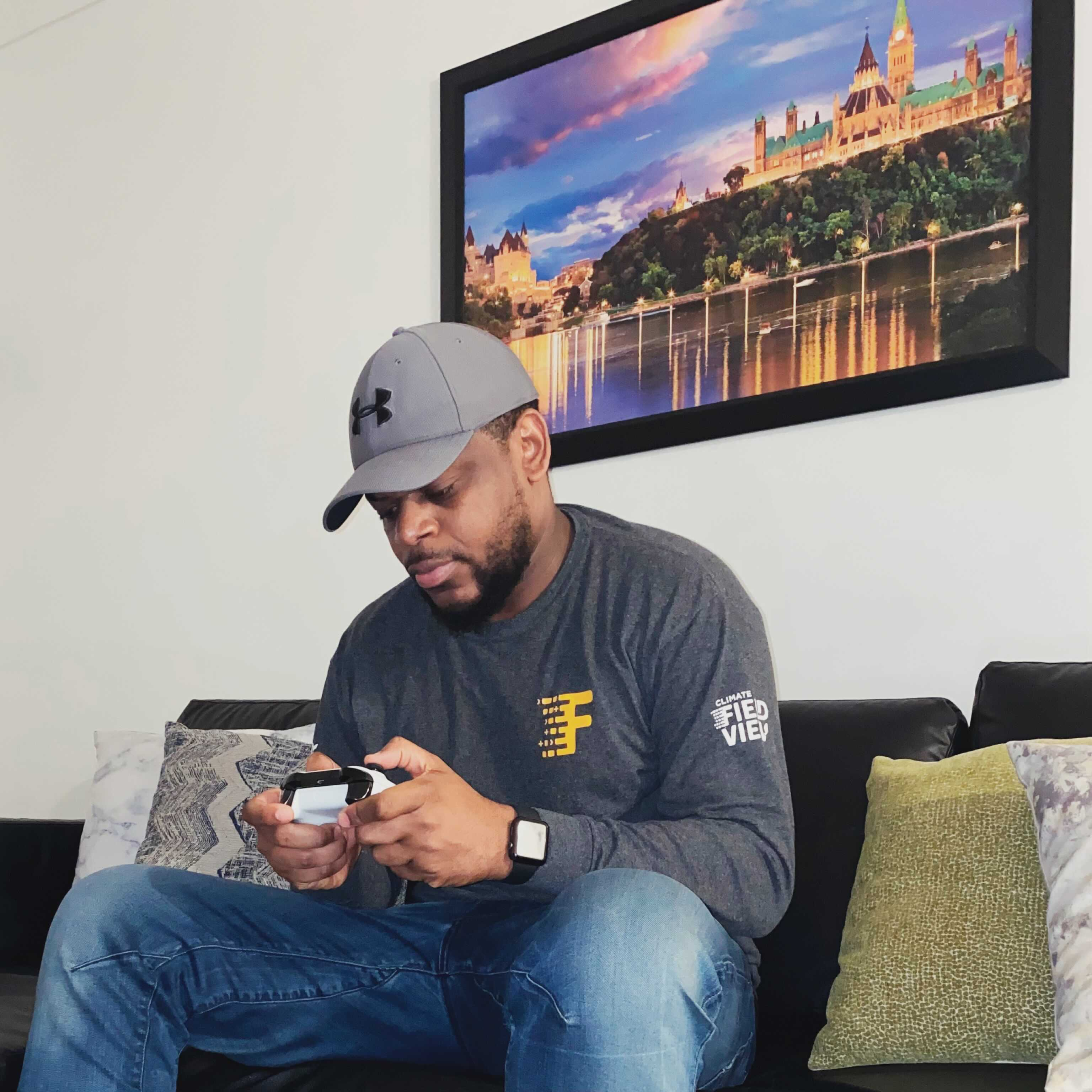Gauthier Mubwa relaxing and playing video games