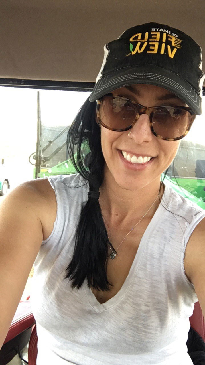 Kim Keller while farming in the cab of her tractor.