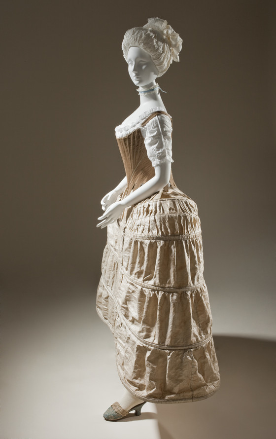 A mannequin wearing full undergarments from the late 1700s