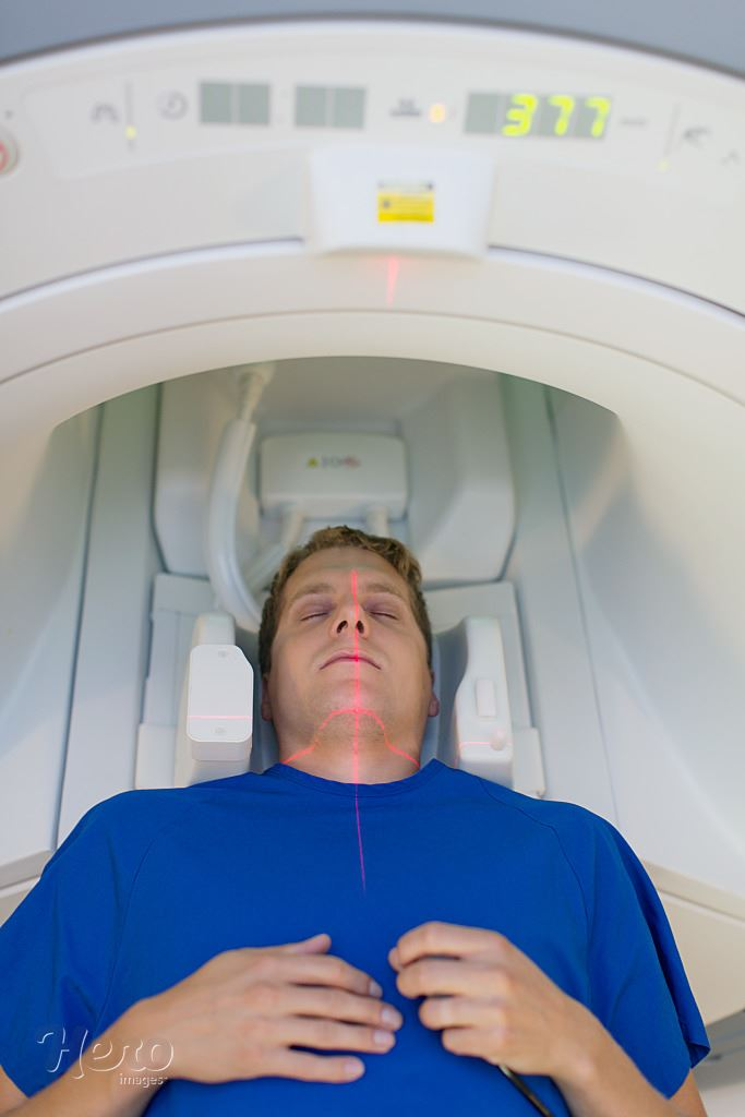 view from above of male patient in MRI scanner | Hero Images