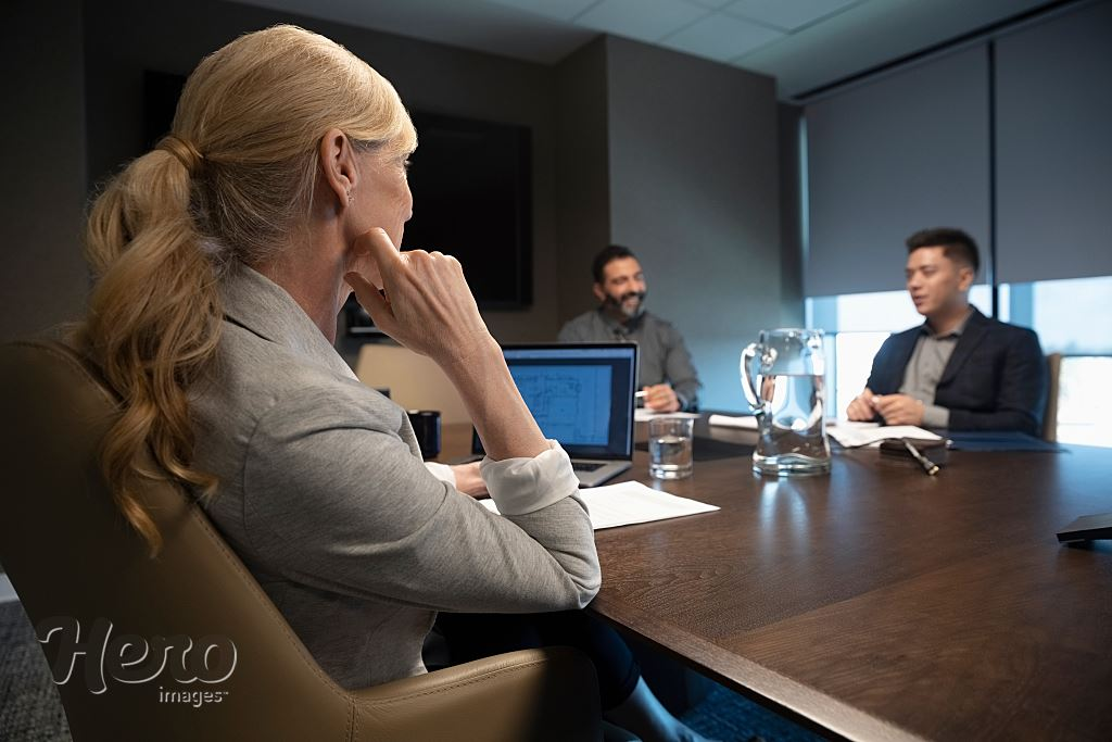Pleasing Businesswoman Listening To Colleagues In Conference Room Home Interior And Landscaping Ponolsignezvosmurscom