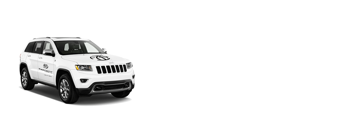 White Jeep Cherokee with Tranont Vinyl Logo Kit Applied to the Vehicle