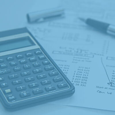 Tax-related Form and Calculator and a Pen