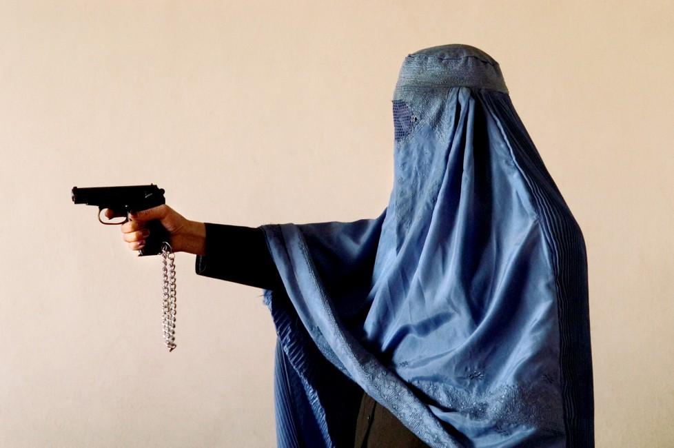 Lana Slezic, </span><span><em>Police Officer with her Gun, 2005</em>, </span><span>Giclee, 24 x 36 inches