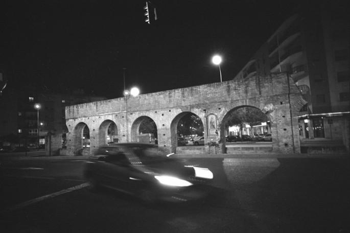George  S. Zimbel, </span><span><em>Auto &amp;amp; Aqueduct, Seville 2001</em>, </span><span>16x20