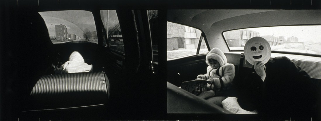 Thomas Barrow, </span><span><em>Masked Don D. &amp;amp; Melissa in T-Town, 1969</em>, </span><span>Gelatin silver print 13.0 x 34.2 cm.