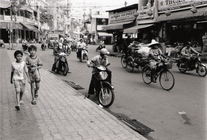 Paul Snowdon, </span><span><em>Boys Walking in Saigon, 2003</em>, </span><span>B&amp;amp;W digital print,  11 x 14