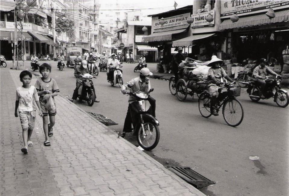 Paul Snowdon, </span><span><em>Boys Walking in Saigon, 2003</em>, </span><span>B&amp;amp;W digital print,  11 x 14