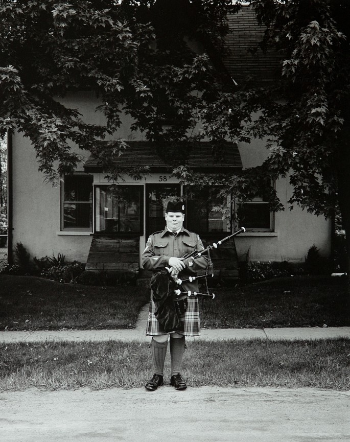 Tom Zsolt, </span><span><em>Cadet with Bagpipes, 2003</em>, </span><span>Silver Print,   13.5