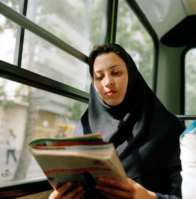 Sanaz Mazinani, </span><span><em>Woman Reading on Bus, Shemiran, 2006.</em>