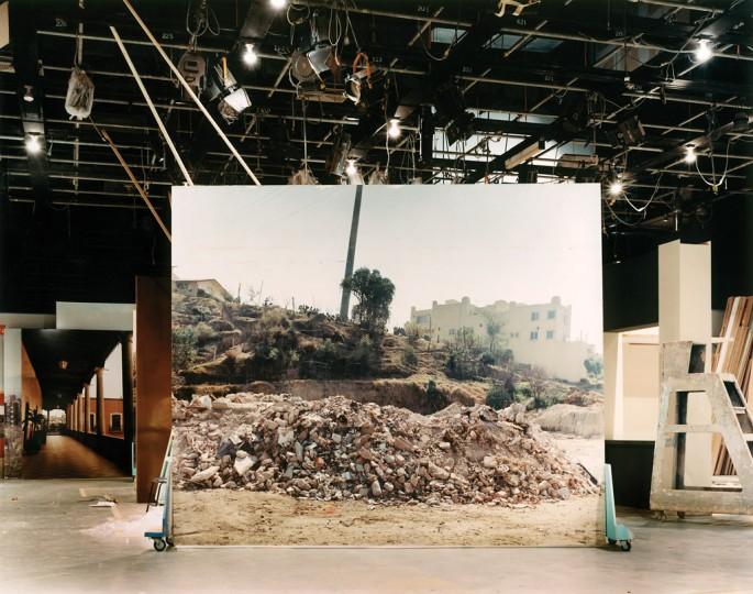 Stefan Ruiz, </span><span><em>Rubble backdrop, 'Amarte es mi Pecado' set, from the series The Factory of Dreams</em>, </span><span>2003 Collection of the artist