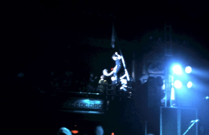 Neill Cunningham, </span><span><em>Fuzzy Bono with Flag</em>, </span><span>1983