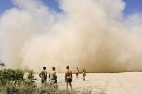 Peter van Agtmael, </span><span><em>U.S. Marines play a game of tossing beanbags into a hole, as a helicopter lands in the background</em>, </span><span>Afghanistan, August 18, 2009 Courtesy of Magnum Photos