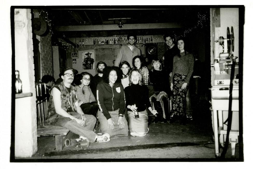 "John Porter, </span><span><em>""Short Experimental Films Completed at Niagara Custom Lab"" screening, the first at Niagara Custom Lab, 254 Niagara St.</em>, </span><span>Toronto - December 7, 2002. L-R, Sitting: Sebastjan Henrickson, Julie Saragosa, Nathan Moles, Christina Battle Michele Stanley, 2002"