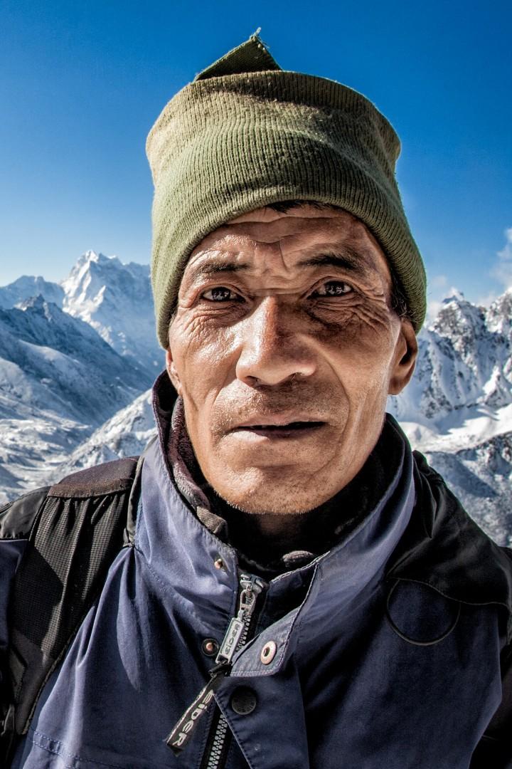 Kristin Lau, </span><span><em>A Sherpa Guide, Everest Region, Gokyo Ri, Nepal</em>, </span><span>2012