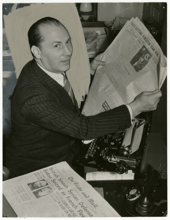 Unidentified photographer, </span><span><em>Boxing great Benny Leonard reading The Globe and Mail sports section</em>, </span><span>c. 1945. Gelatin silver print, 9 × 6.5&quot;. Gift of The Globe and Mail newspaper to the Canadian Photography Institute of the National Gallery of Canada.