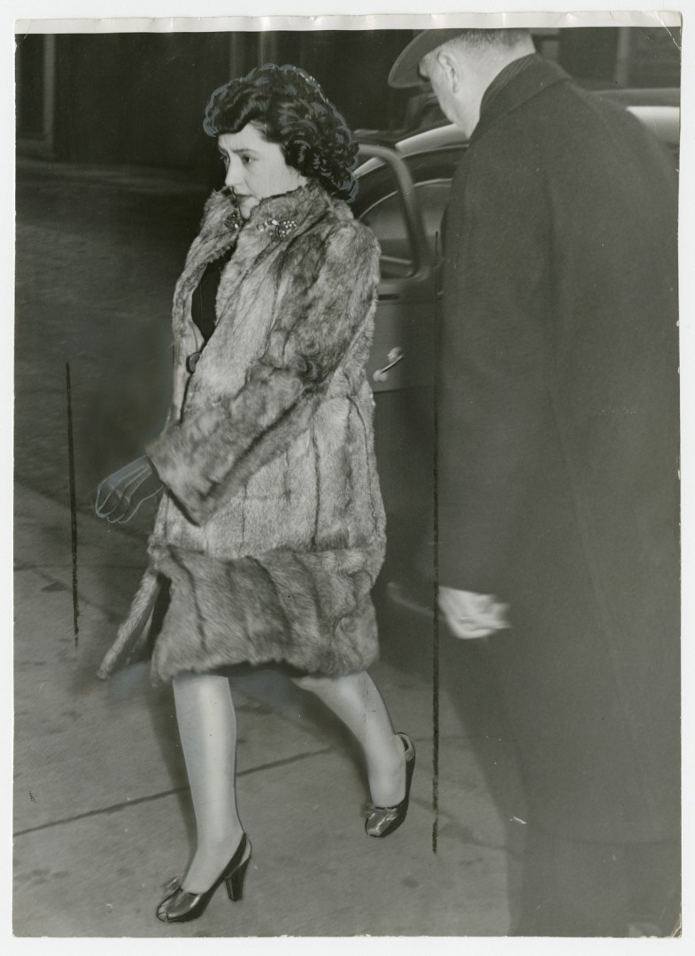Unidentified Photographer, </span><span><em>Looking stouter after months of close confinement, Mrs. Evelyn Dick leaves Hamilton jail on her way to the court house</em>, </span><span>1947. Gelatin silver print, 9.5 x 7&quot;. Gift of The Globe and Mail newspaper to the Canadian Photography Institute of the National Gallery of Canada.