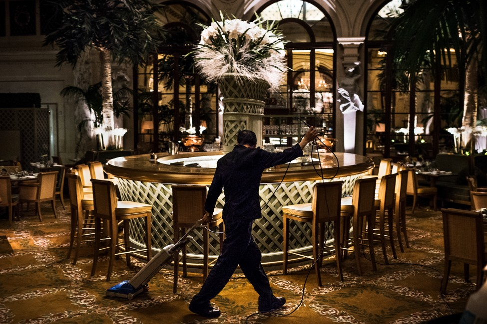 Aaron Vincent Elkaim, </span><span><em>Lau Chun-Tai cleans the Palm Court. He has been doing custodial work on the night shift at The Plaza, a Fairmont managed hotel, for 8 years.</em>, </span><span>2016. Courtesy of NAMARA represents.
