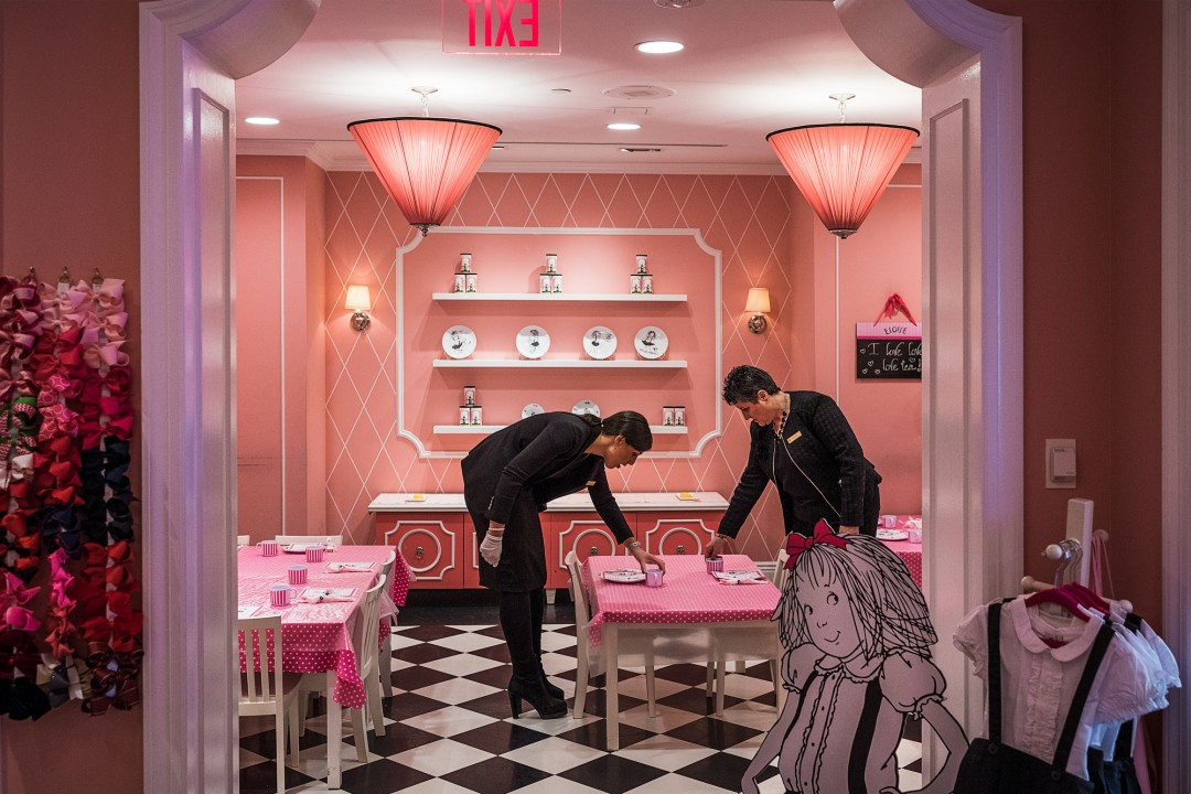 Aaron Vincent Elkaim, Laurence Ledanois, a staff member of 19 years (right) arranges tables with Jessica Azoulai for tea time at the Eloise Boutique at The Plaza, a Fairmont managed hotel, in New York., 2016. Courtesy of NAMARA represents.